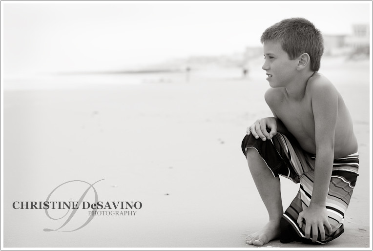 boy-looks-out-at-ocean-lbi-nj