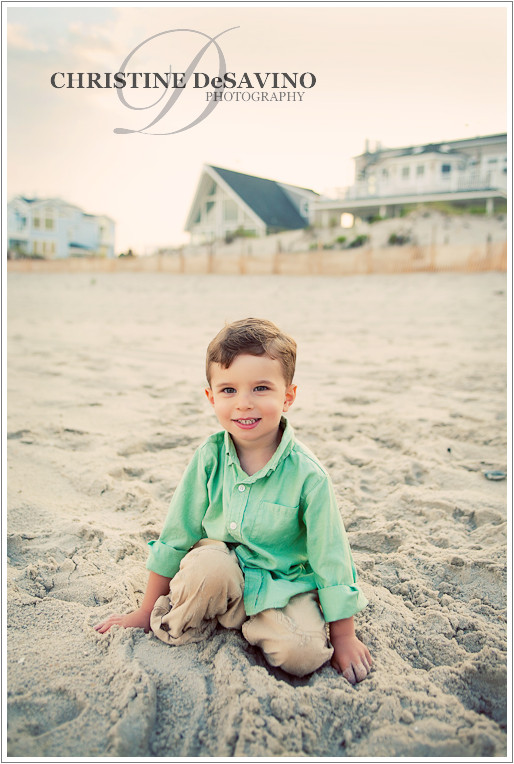 Handsome boy in the sand on the beach at Long Beach Island