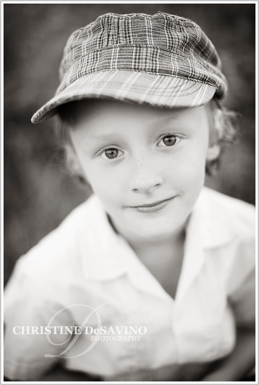 black and white image of boy with hat