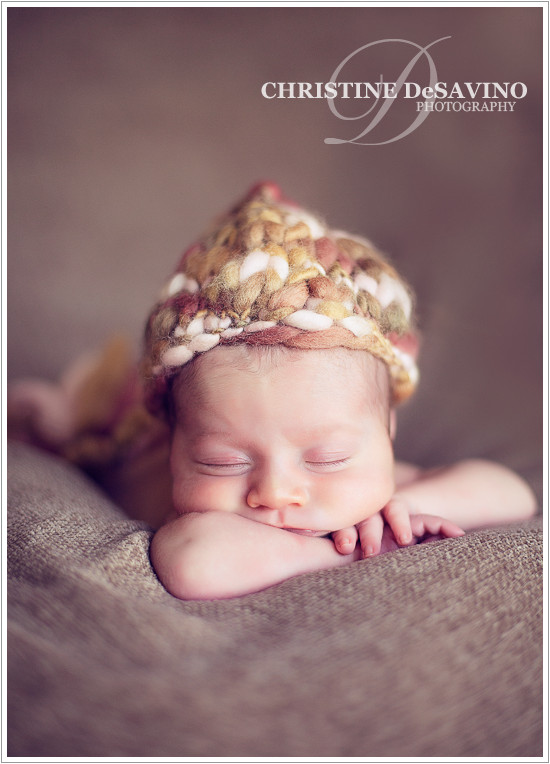 Newborn girl sleeping in beautiful knit hat - NJ Newborn Photographer
