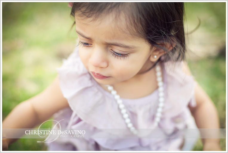 Close up of little girl wearing pearls - NY Child Photographer