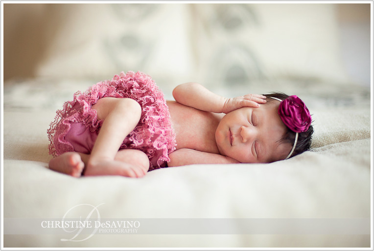 Newborn baby girl with pink bow & bloomers - NJ Newborn Photographer