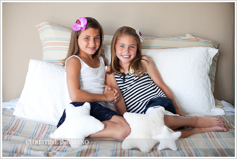 Sisters on bed with star pillows - NJ Beach Photographer