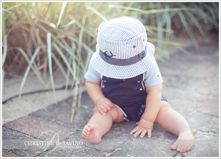 Boy in hat on boardwalk - NJ Beach Photographer