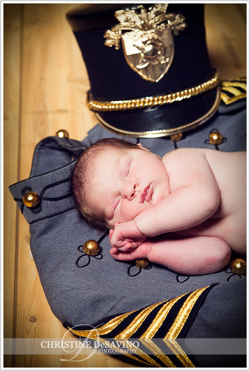 Baby girl sleeps on cadet uniform - NJ Newborn Photographer