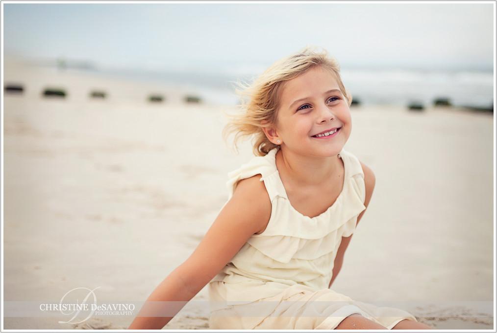 Girl sitting on beach - NJ Beach Photographer